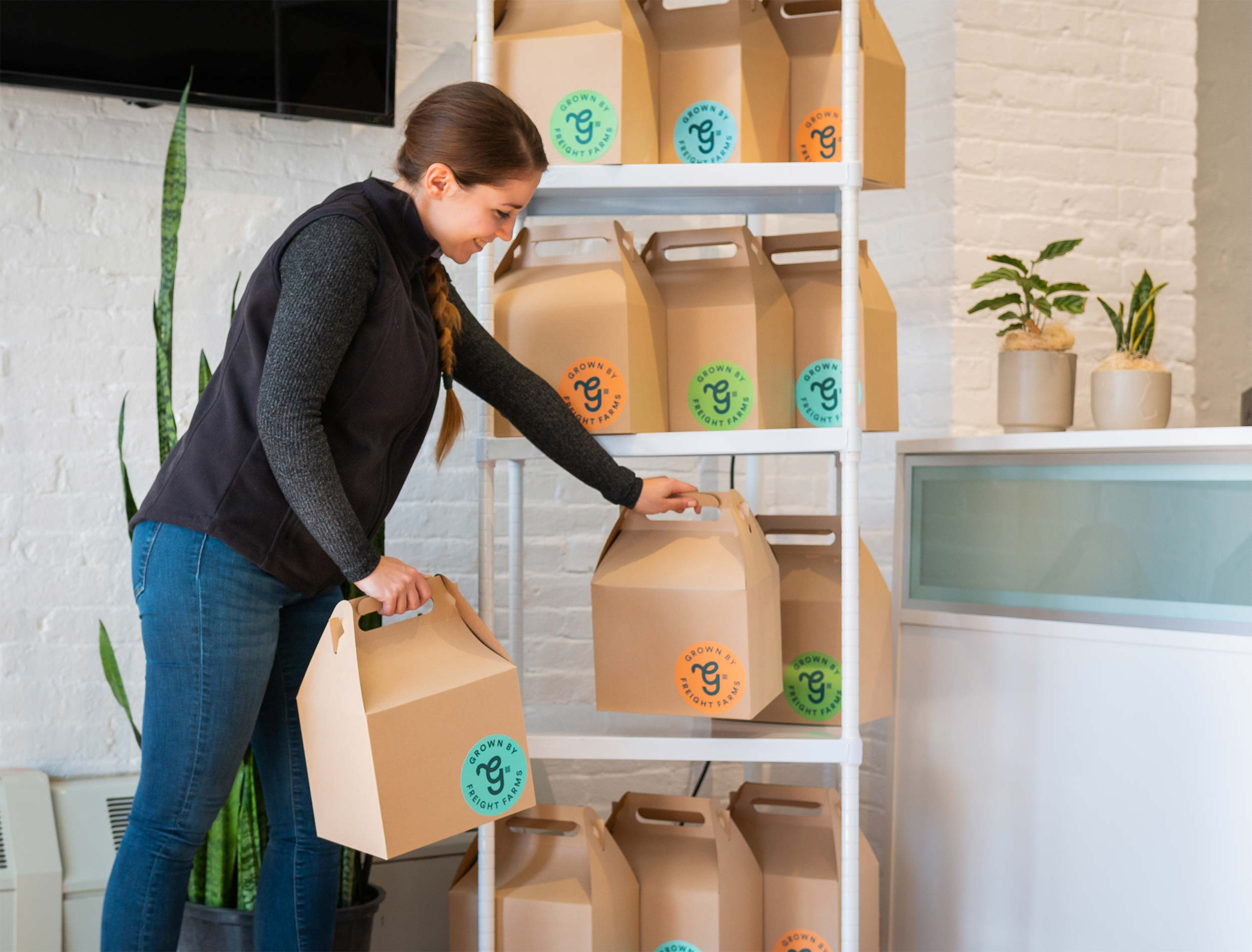 Francesca delivers individually packaged shares to various WeWork locations.