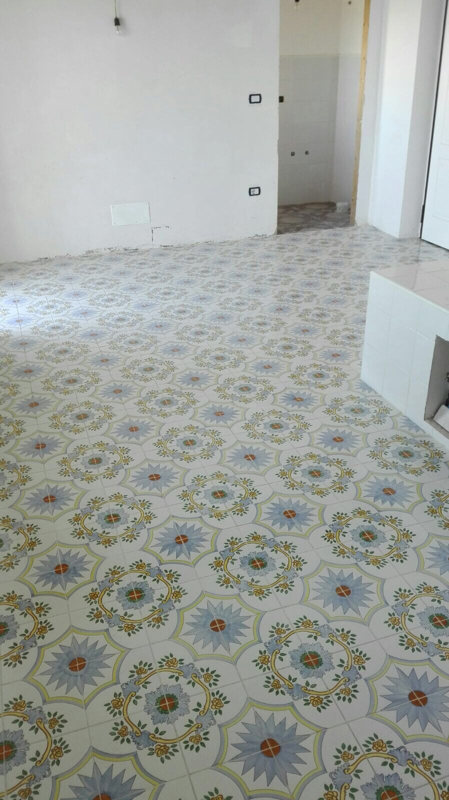 Dependance: kitchen not yet delivered but floor tiles look great!