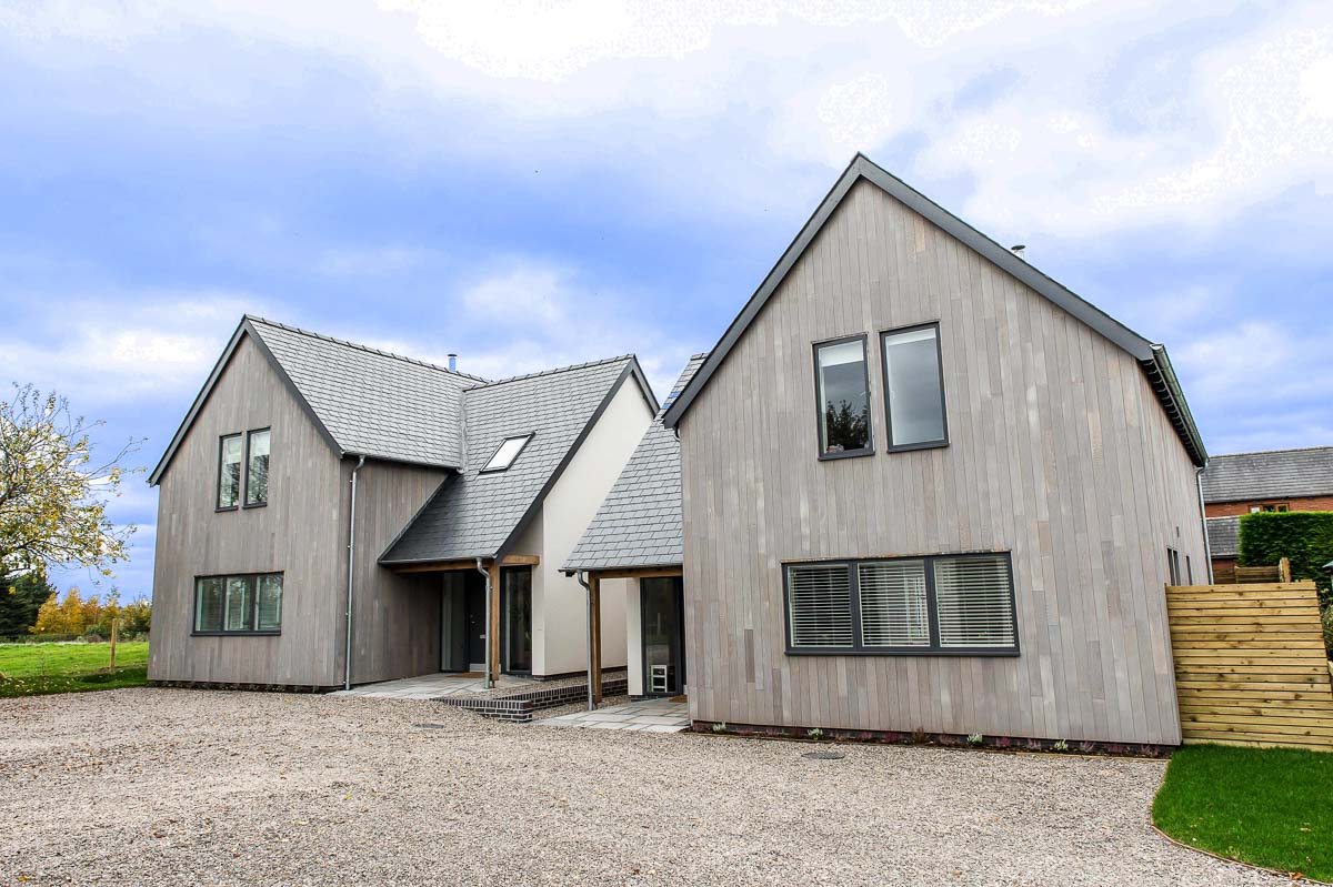 Modern House Build horizontal grey wood by JDW Building and Conservation.jpg