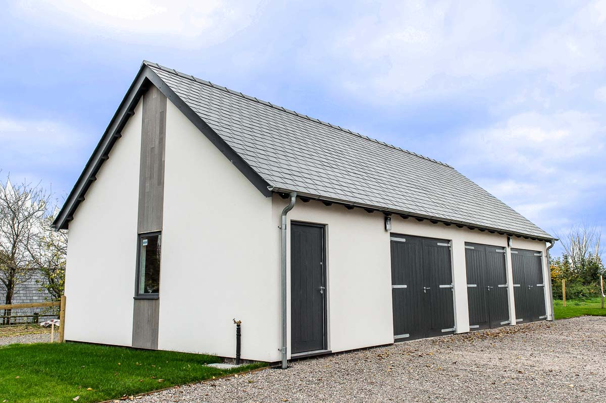 Modern House Build horizontal grey wood by JDW Building and Conservation2.jpg