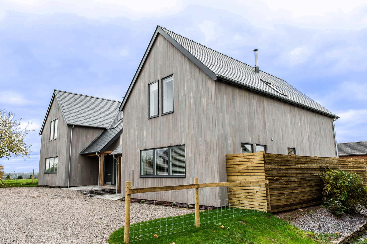 Modern House Build horizontal grey wood by JDW Building and Conservation3.jpg