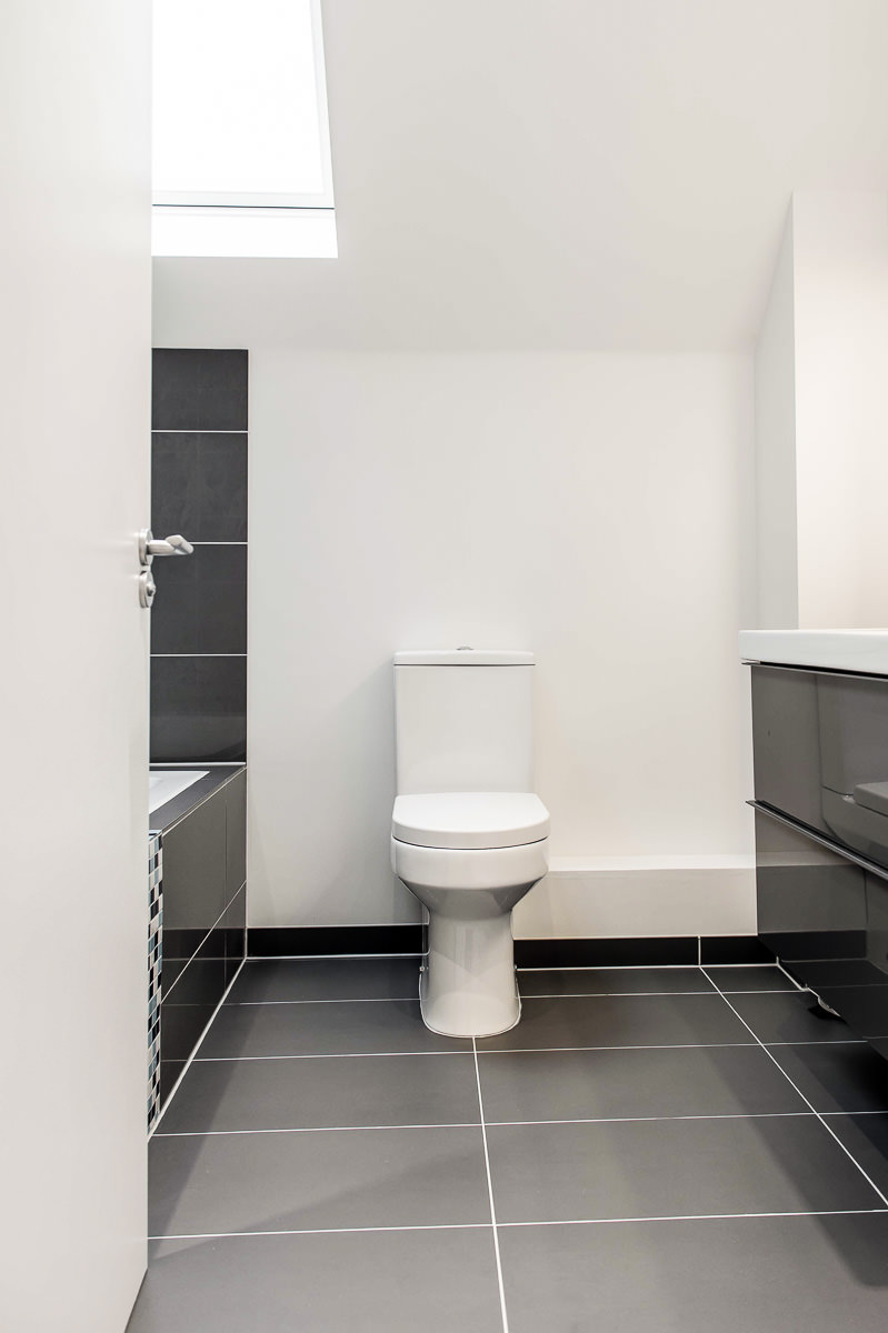 Modern House Build Bathroom Grey1 by JDW Building and Conservation.jpg