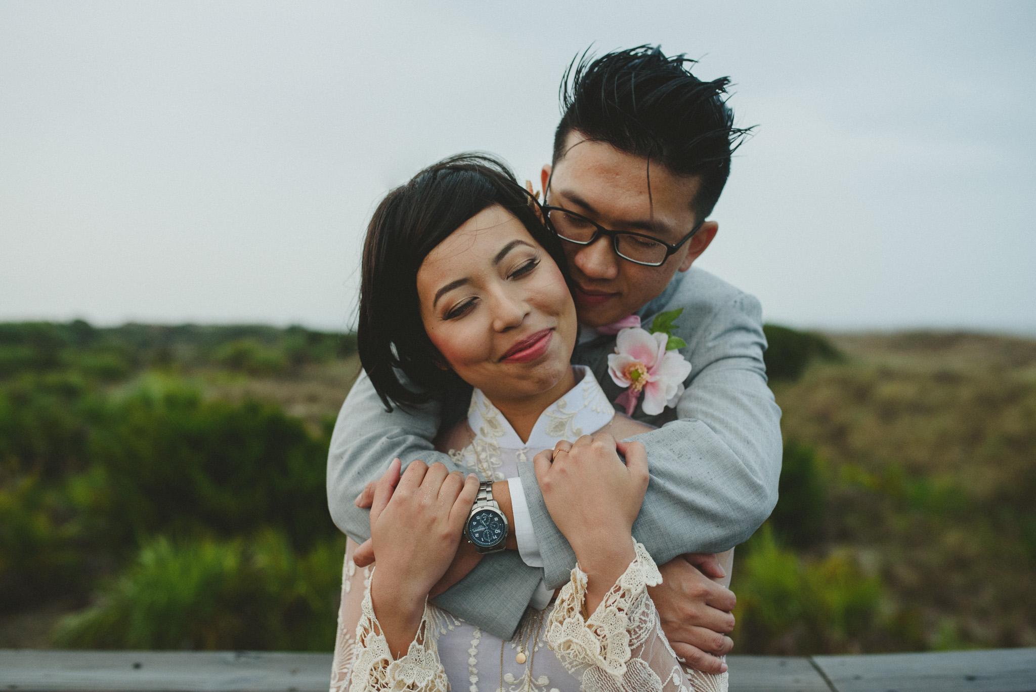 Tybee Island Wedding Photographer - Couple hugging