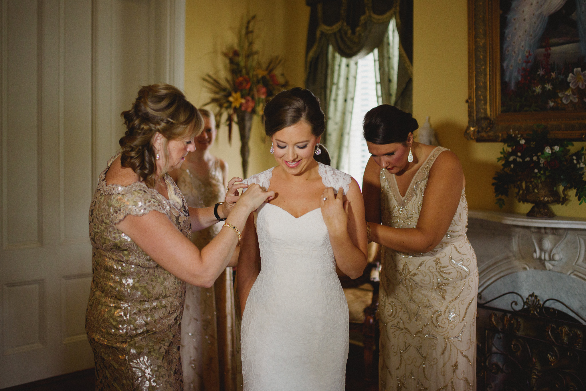 Savannah Photography - Bride getting dresses
