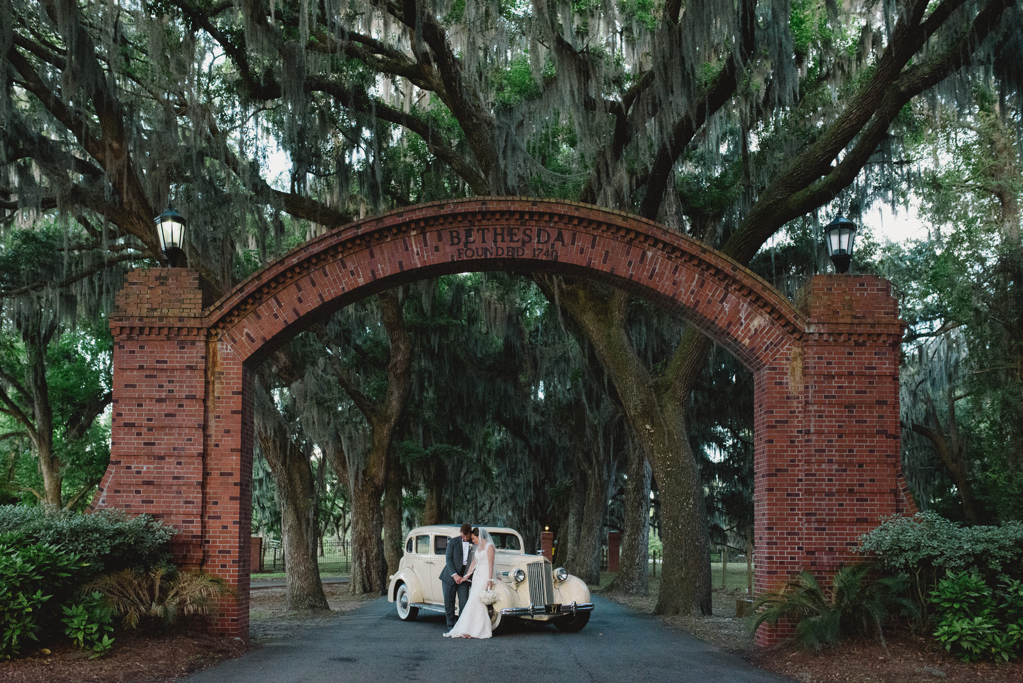 Savannah Wedding Photographer - Bride and Groom at Bethesda with classic car