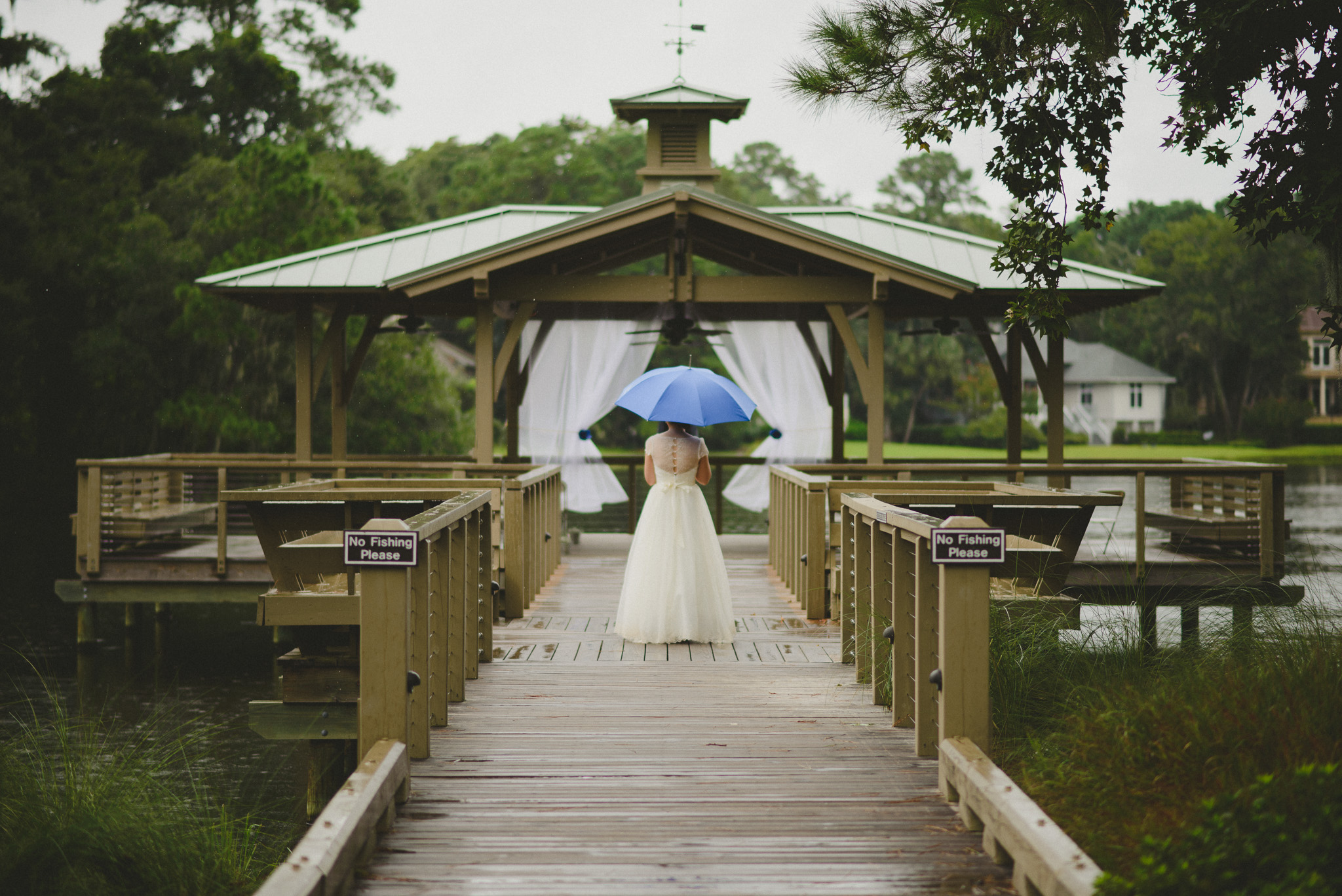 Hilton Head Wedding Photographer - Bride in rain with umbrella