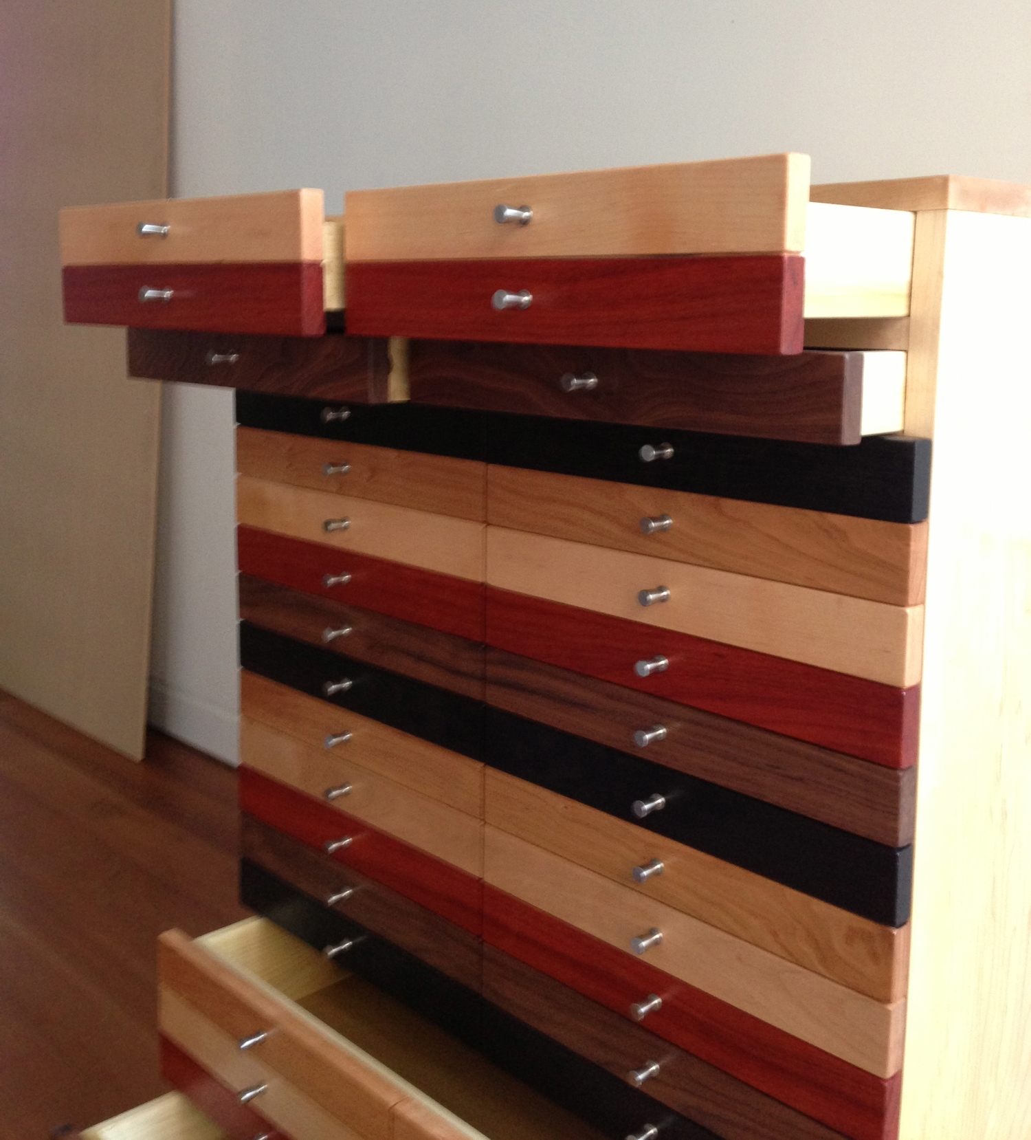 At first glance, this cabinet appears to have forty-twosmall drawers, but it has six drawers of varying sizes and a cabinet.
