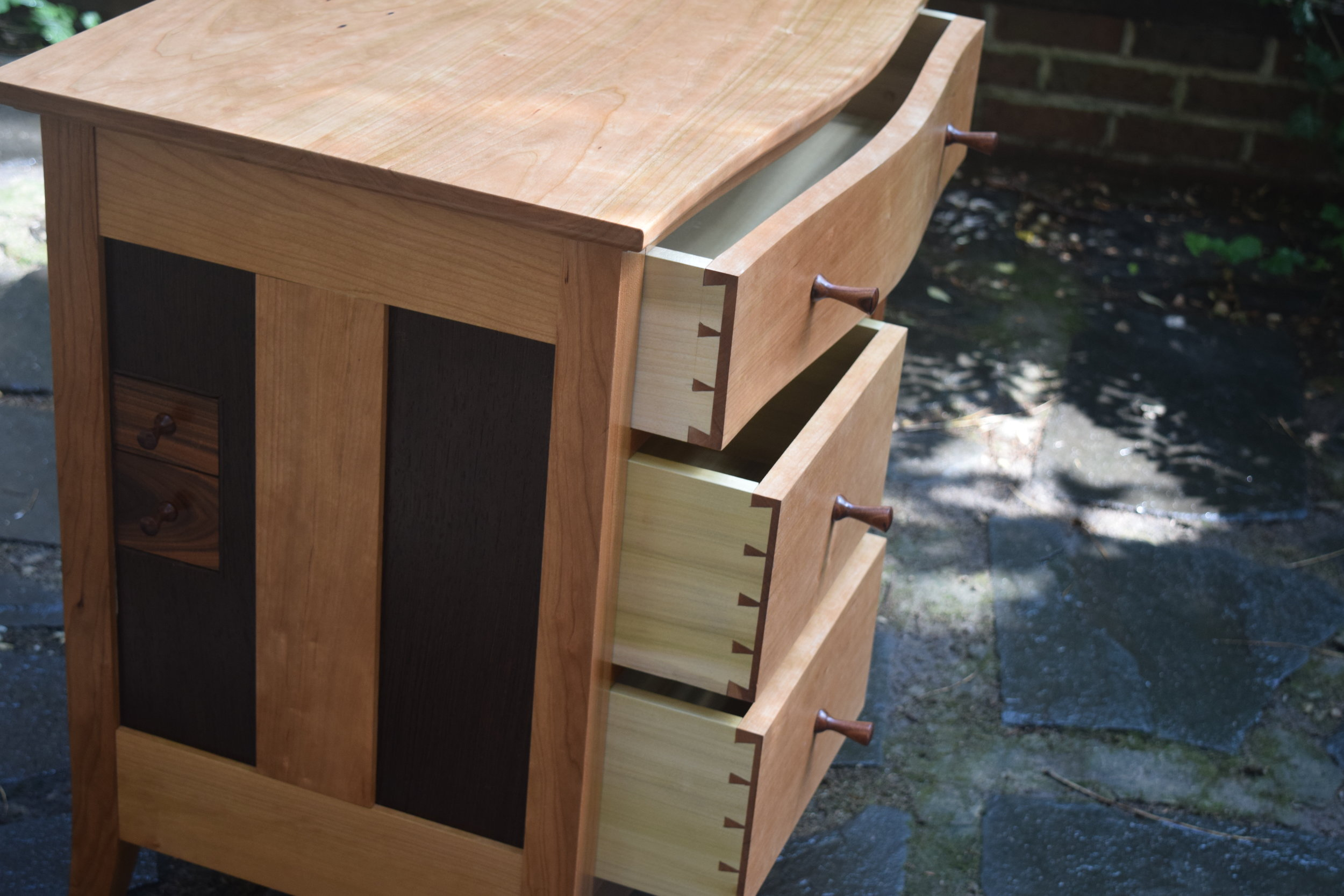 Hand cut dovetails.   Each drawer is individually fit to be snug, yet move easily.