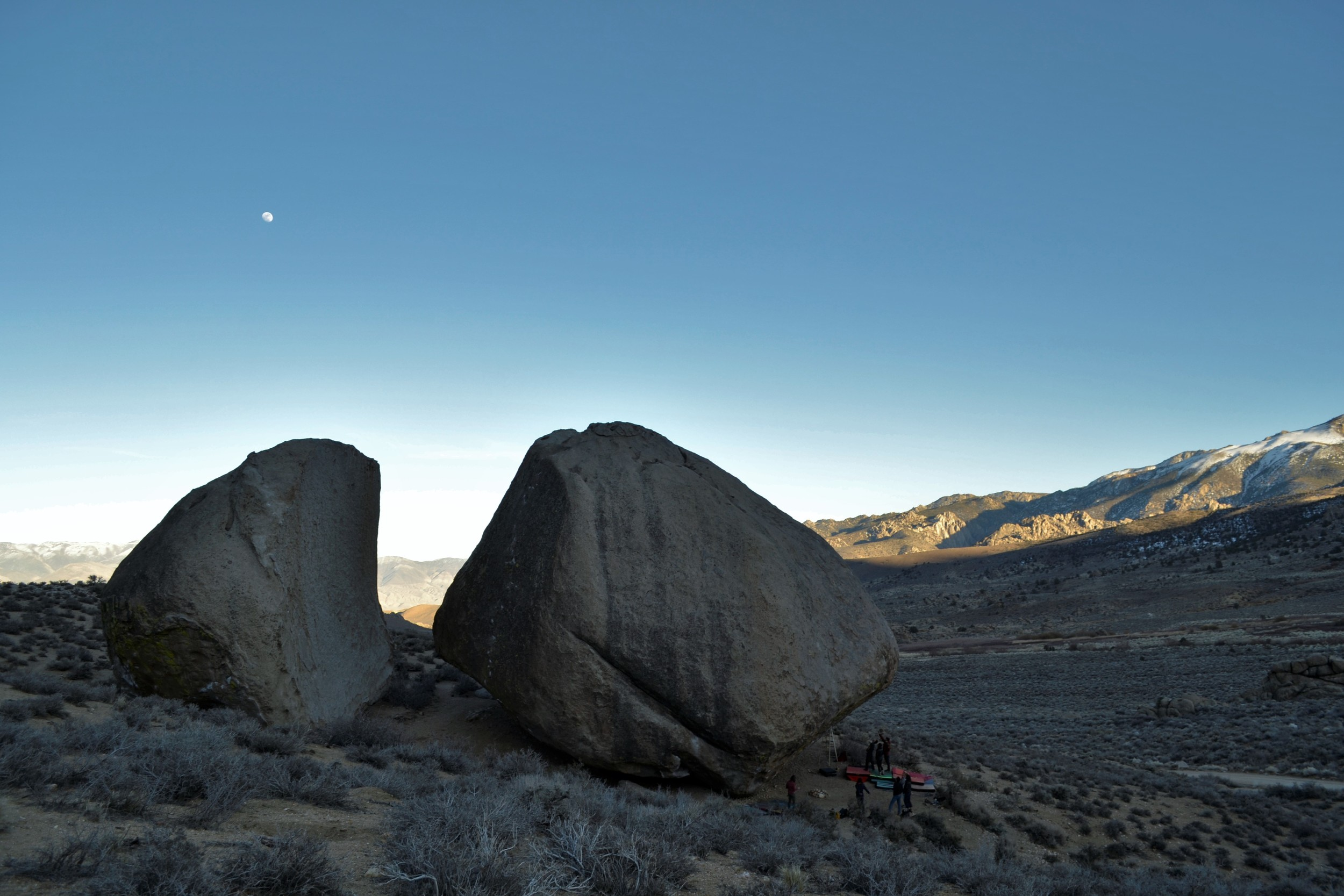 The moon rising over Bishop's famous Grandma and Grandpa Peabody boulders