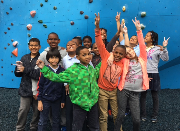 Kids from our ClimbUp Program on a summer day at DUMBO Boulders