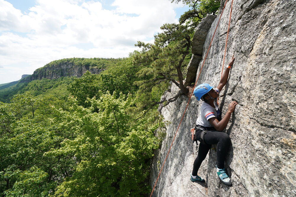 YWWC at the crag during one of two annual outdoors trips // Photo via  Young Women Who Crush