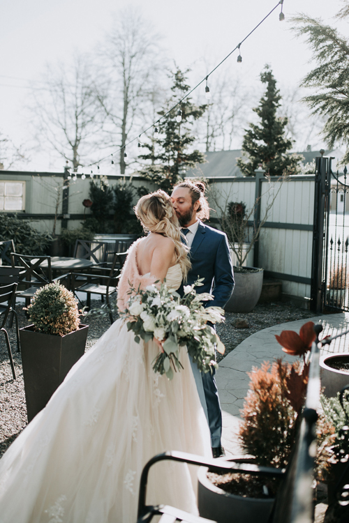 Wedding kiss in outdoor garden