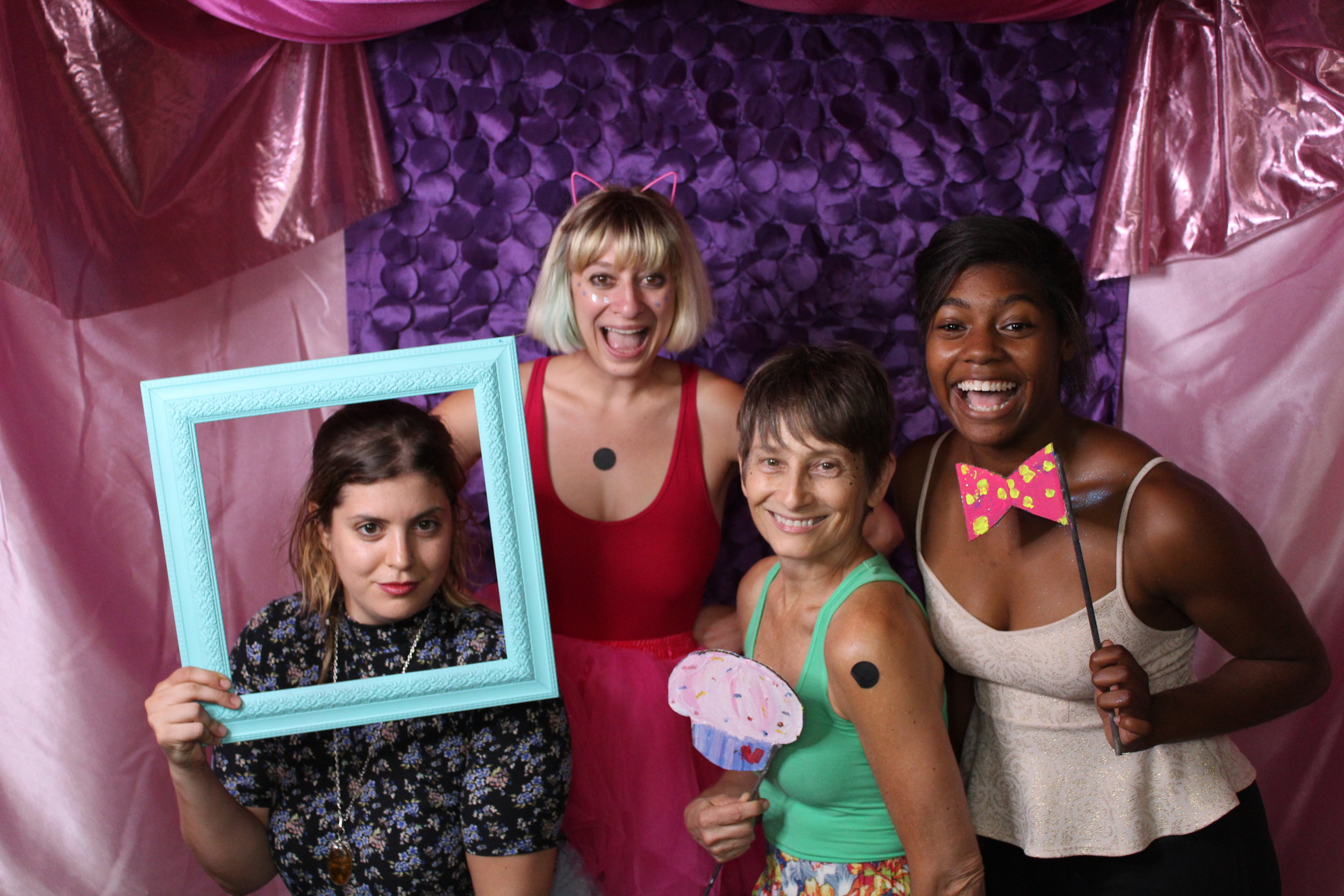 Xenia Simos, Willow Goldstein, Olive Hagemeier, and Onyx Simpson pose for a photo together at The Bakery's birthday party. Image by Matt Kelly.