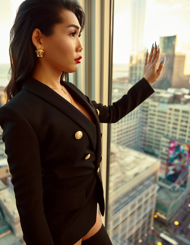 Blazer: Balmain, Jewelry: Versace