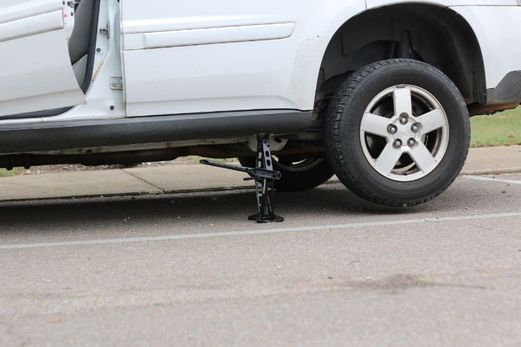 Use a jack to lift your vehicle off the ground. Photos by Braxton Maclean.