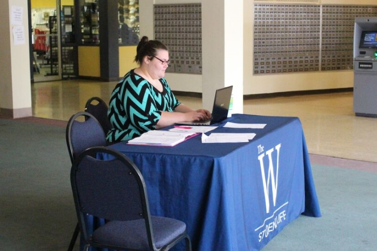 Harli Eaves prepares to register blood donors. Photo by Joanna Frye.