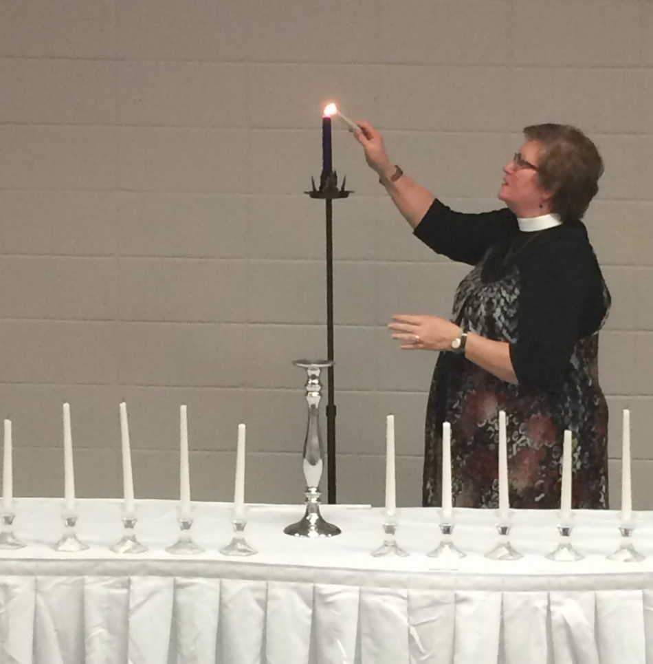The candle representing senior spirit is lit at 100th Night. Photo by Lauren Trimm.