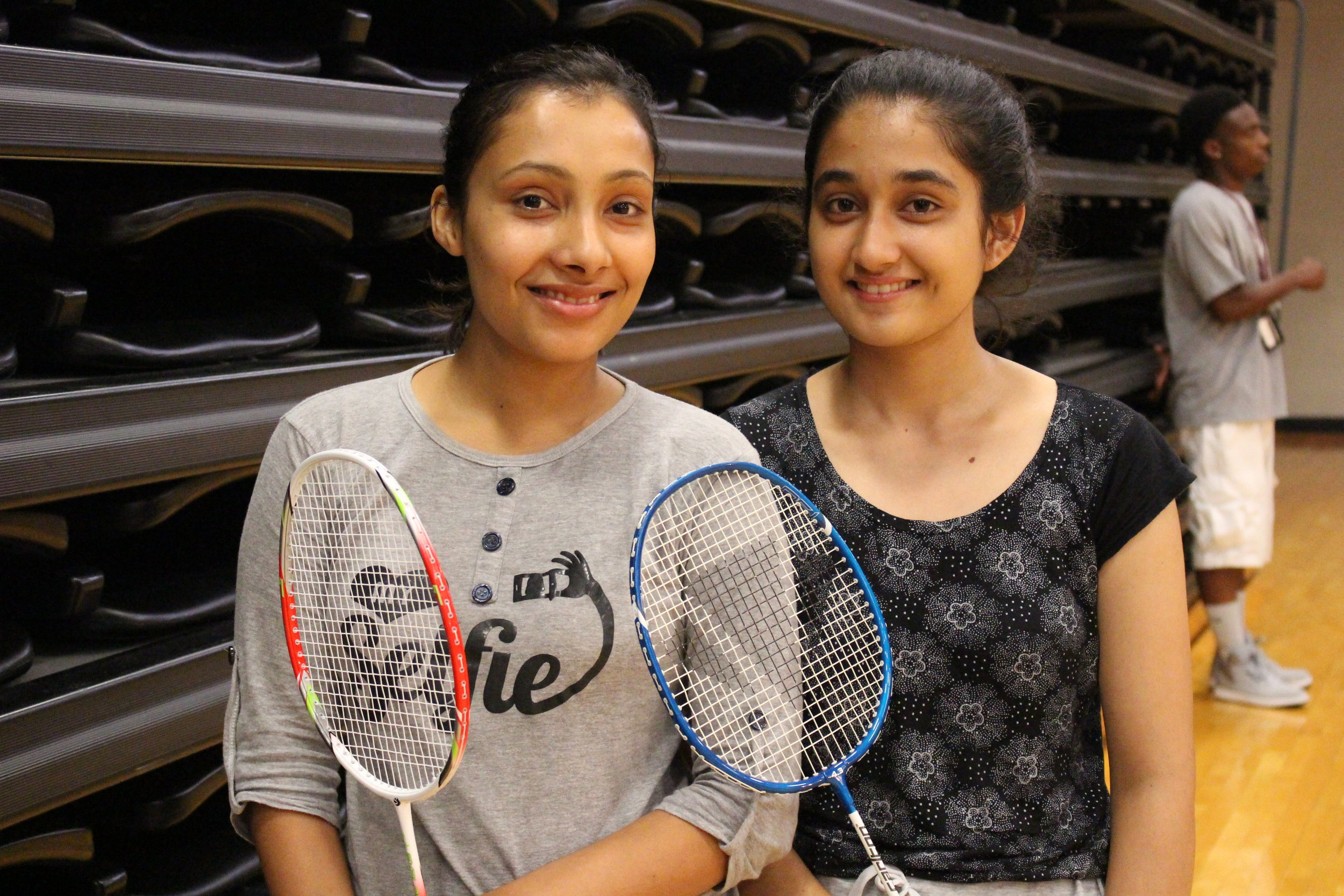Mahima Acharya and Anugya Shiwakoti show off their rackets for the badminton tournament. Photo by Casandra Anderson.