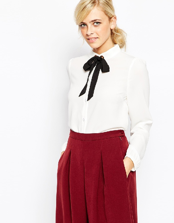 I will never let the necktie go. The chic-est staple of them all...a simple, white blouse.  Get it   HERE!