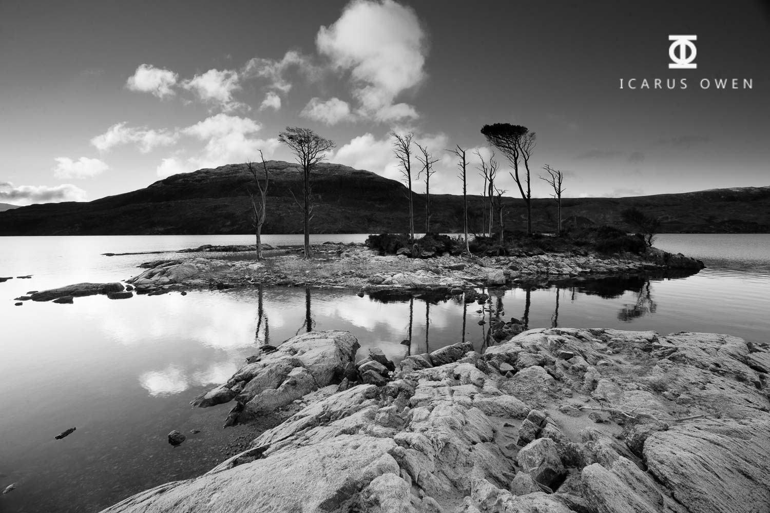 Island on Loch Assynt with frost on the foreground rocks.
