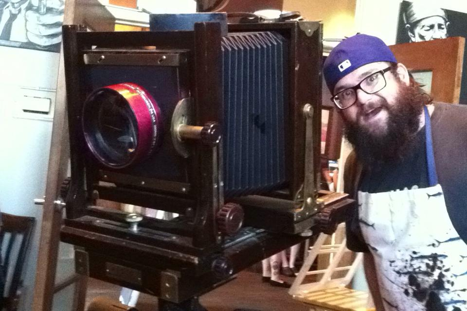 Bryan showing off the Barbatype Wonder-Camera.   It's an Ansco-View 5x7 from the 1920's.  The big red lens is re-purposed from a slide projector.  We are resourceful and thrifty people here, in Project Barbatype.