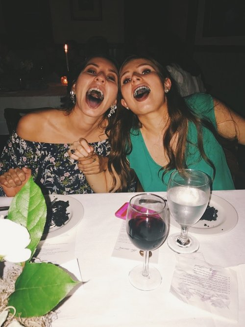 Here I am eating cake at my friend's wedding rehearsal dinner. the cake made our mouths turn a funny color and clearly we needed to capture the moment because we are 5 years old.