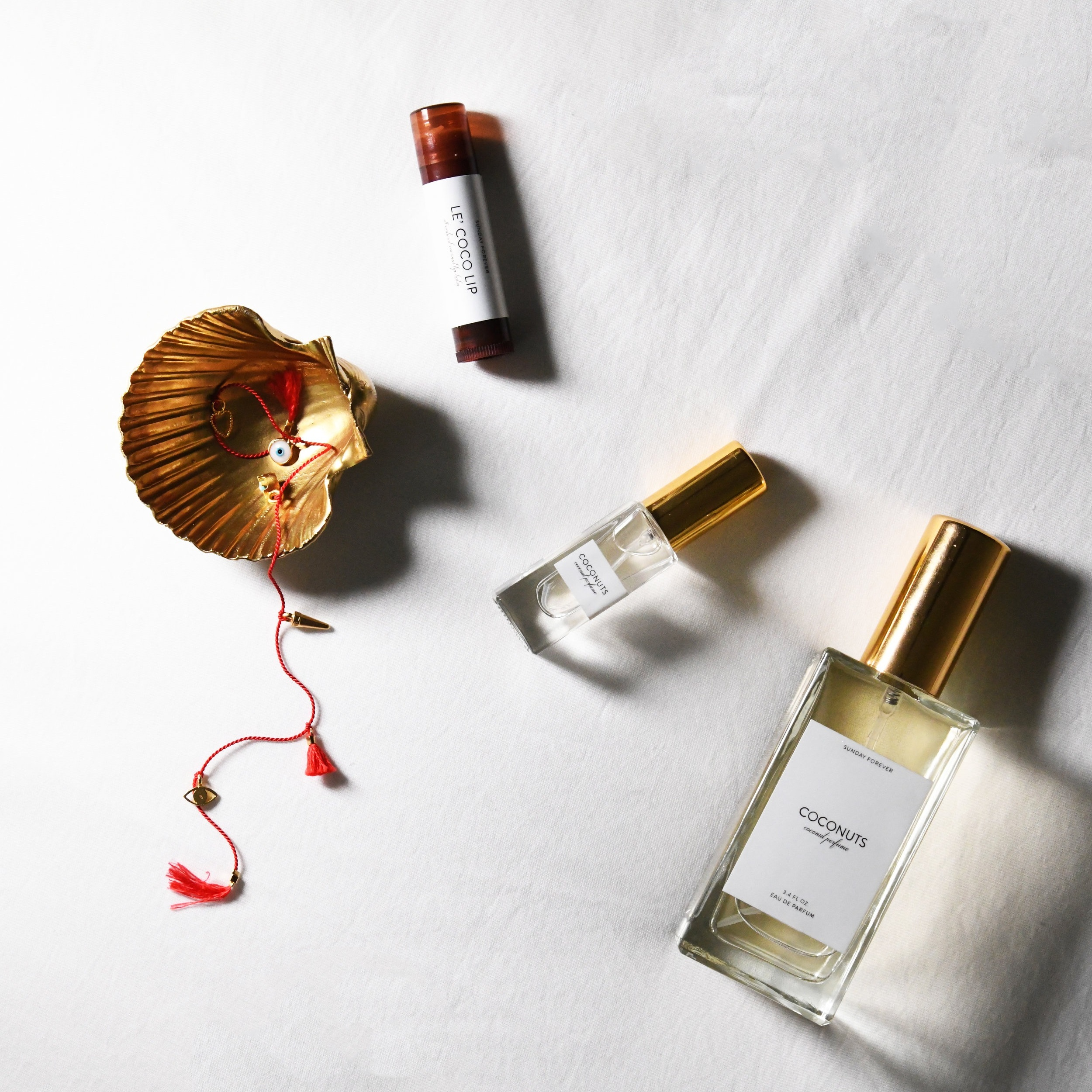 SUMMER FOREVER - EVERYTHING YOU NEED TO MAKE YOUR SUMMER DREAMS COME TRUE. THE PERFECT COCONUT PERFUME, TANLINES CANDLES, LE'COCO LIP BALM, AND ANKLETS, SO MANY ANKLETS.