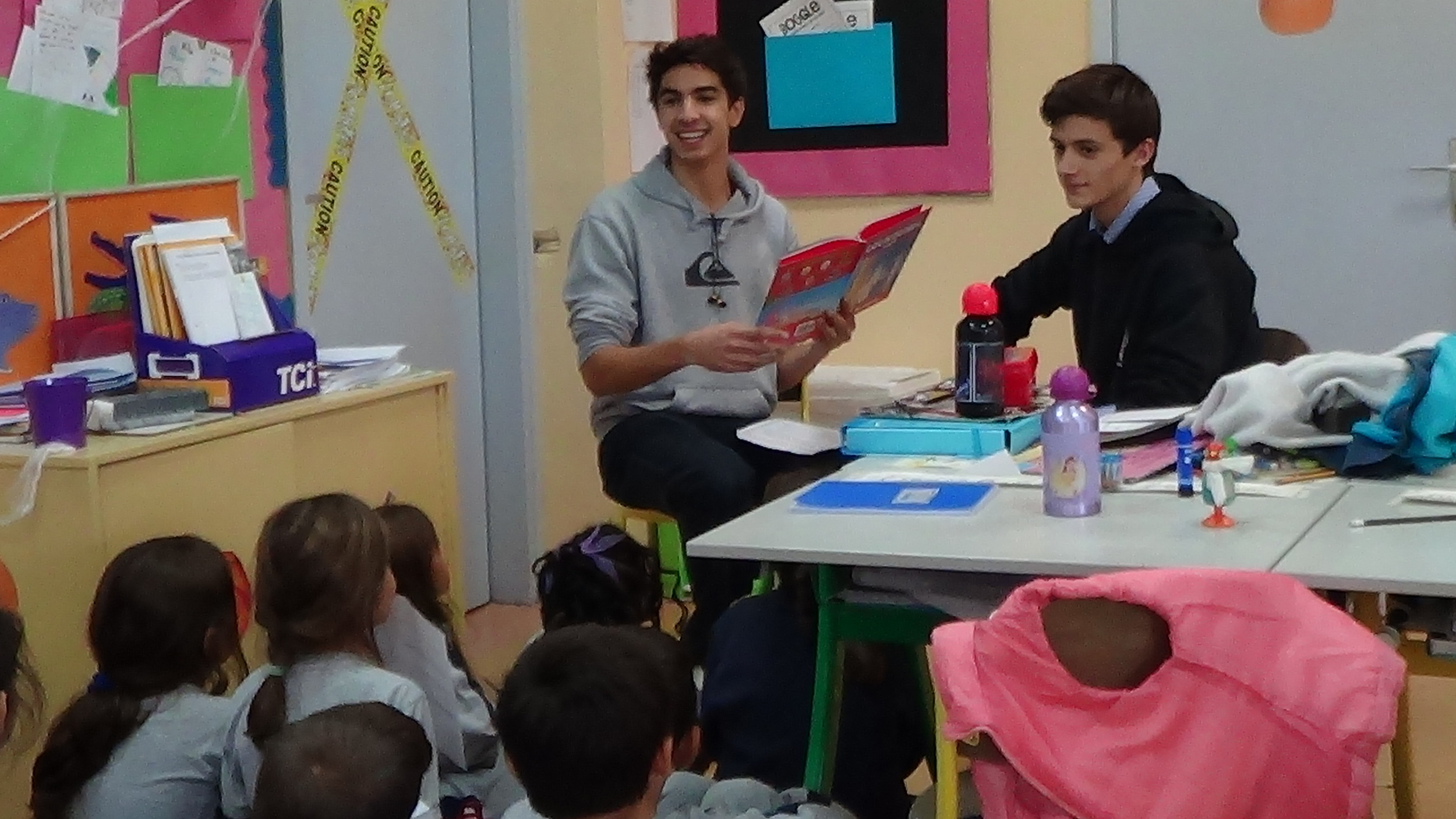 ARIS & ACHILLEAS READ LOUKOUMI'S GOOD DEEDS TO ACS ATHENS 3RD GRADERS.JPG