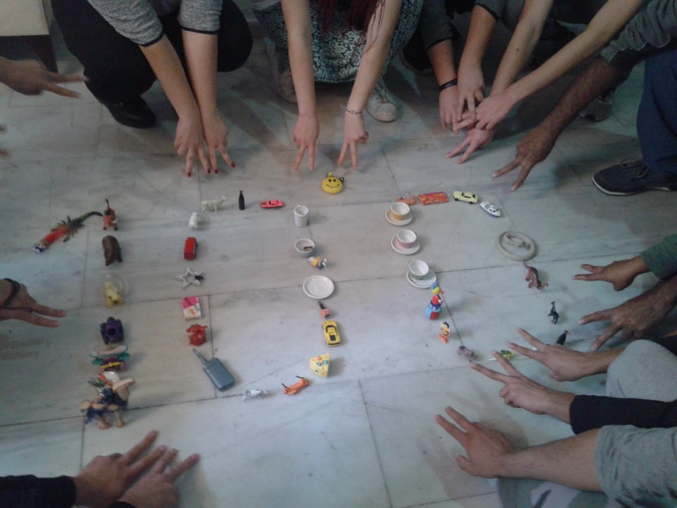 Empowering refugee unaccompanied minors with PeaceJam. Youth create the number 100 with toys in support of Nobel Peace Laureate Kalaish Satyarthi's 100 Million Campaign — putting an end to child slavery, poverty, trafficking and war.