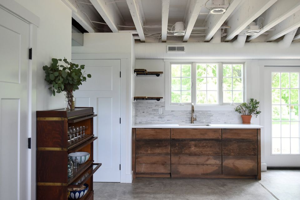 The French door and window over the sink were added to bring more natural light into the space.  I'm geeked about the dishwasher which is custom panel ... do I maybe have the only reclaimed barn wood dishwasher in the world?  I like to think so :)
