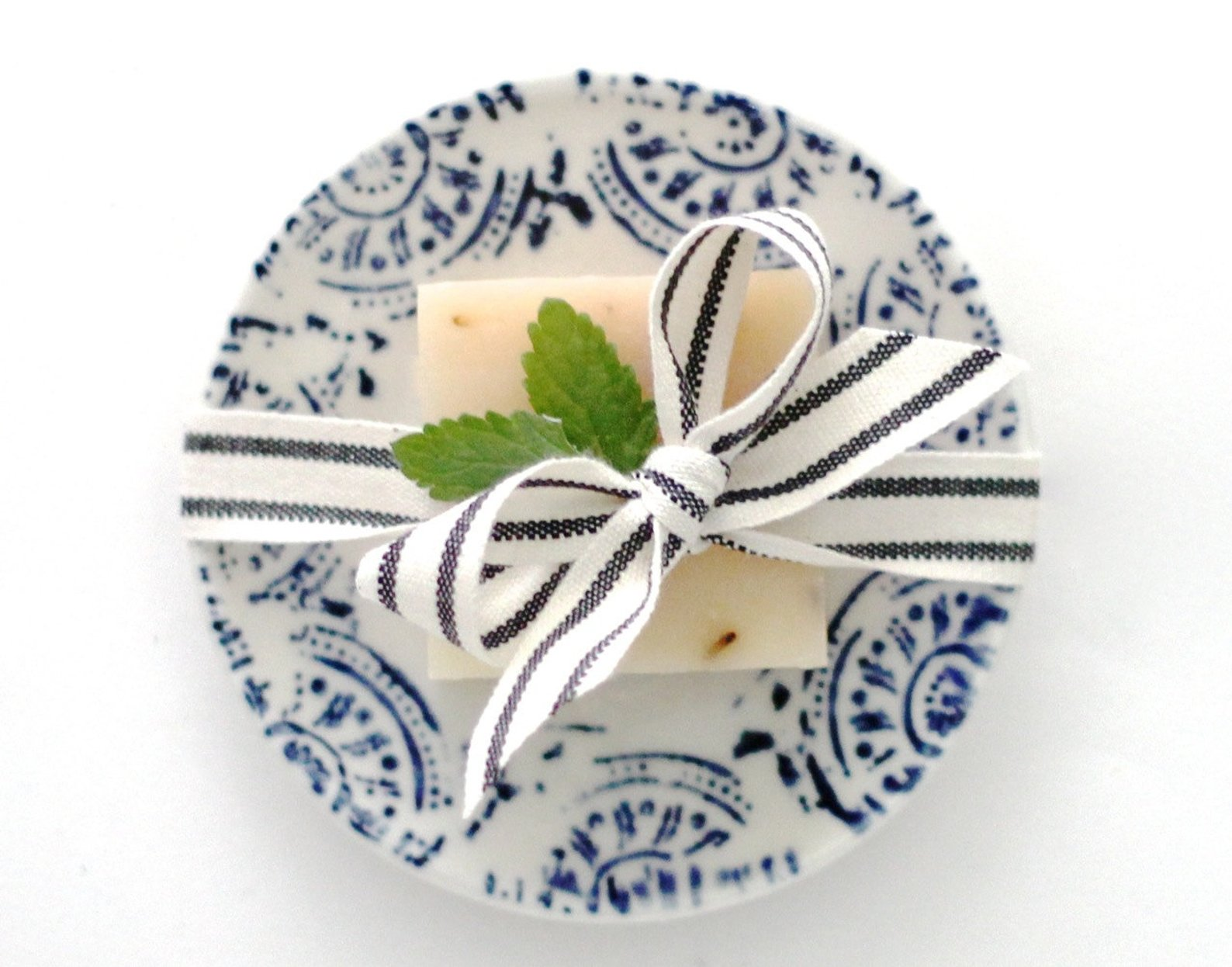 Here is the soap dish we dreamed up and Edith made!!  This dish is not available on her site but you can buy it in  our shop HERE  while supplies last.  The soap is our most popular Lavender Lemongrass and it comes tied with this ticking ribbon and gift boxed with a navy ribbon and gift tag for no additional charge so it can be sent directly to your mom for mother's day for example.