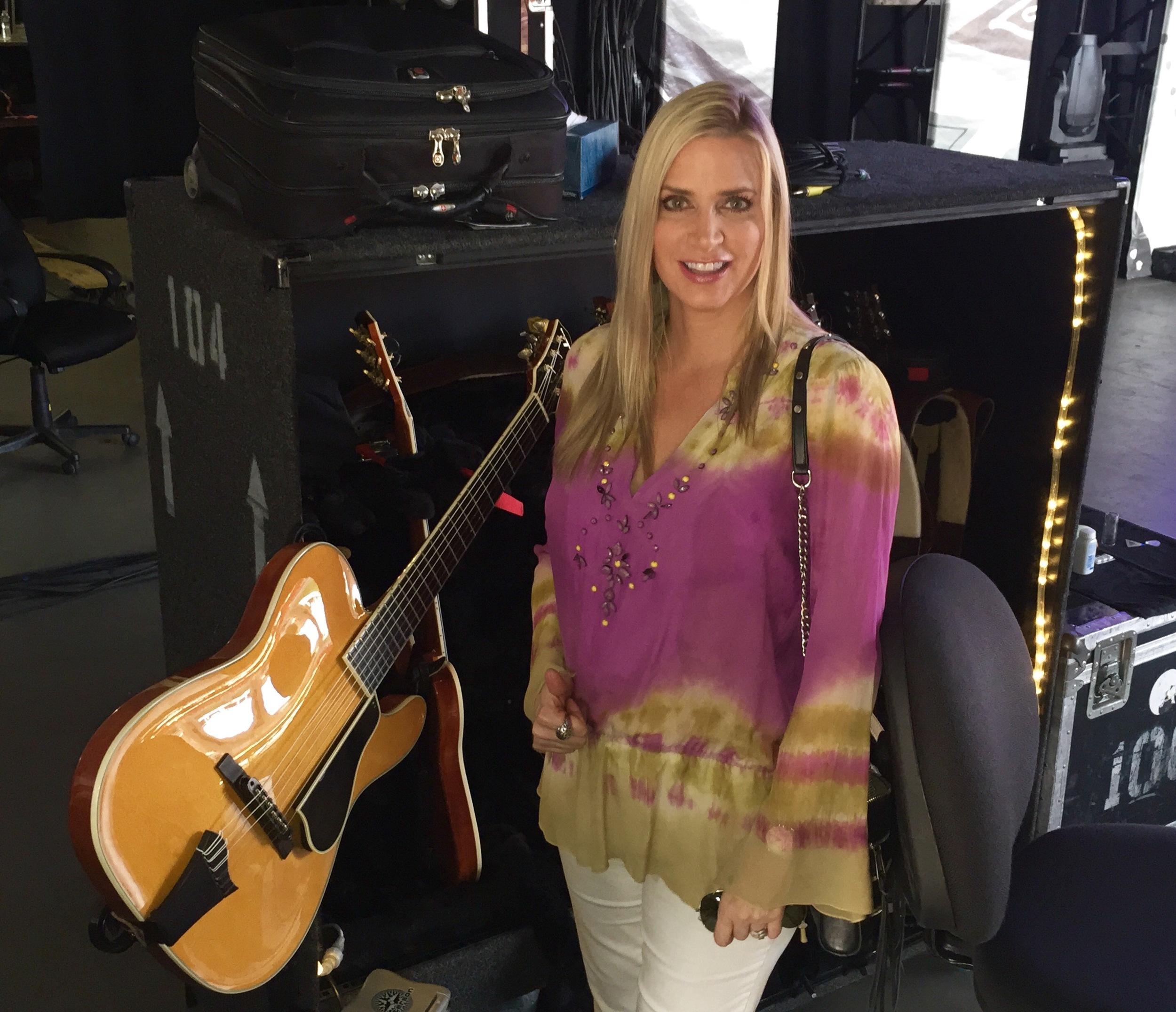 "Mrs. Q with Santana's ""Maria Maria"" guitar."