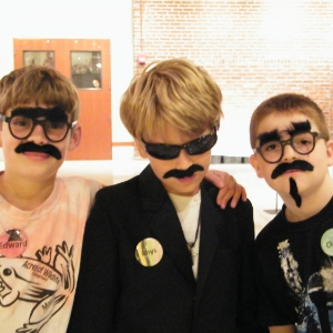 Image of children in spy costumes