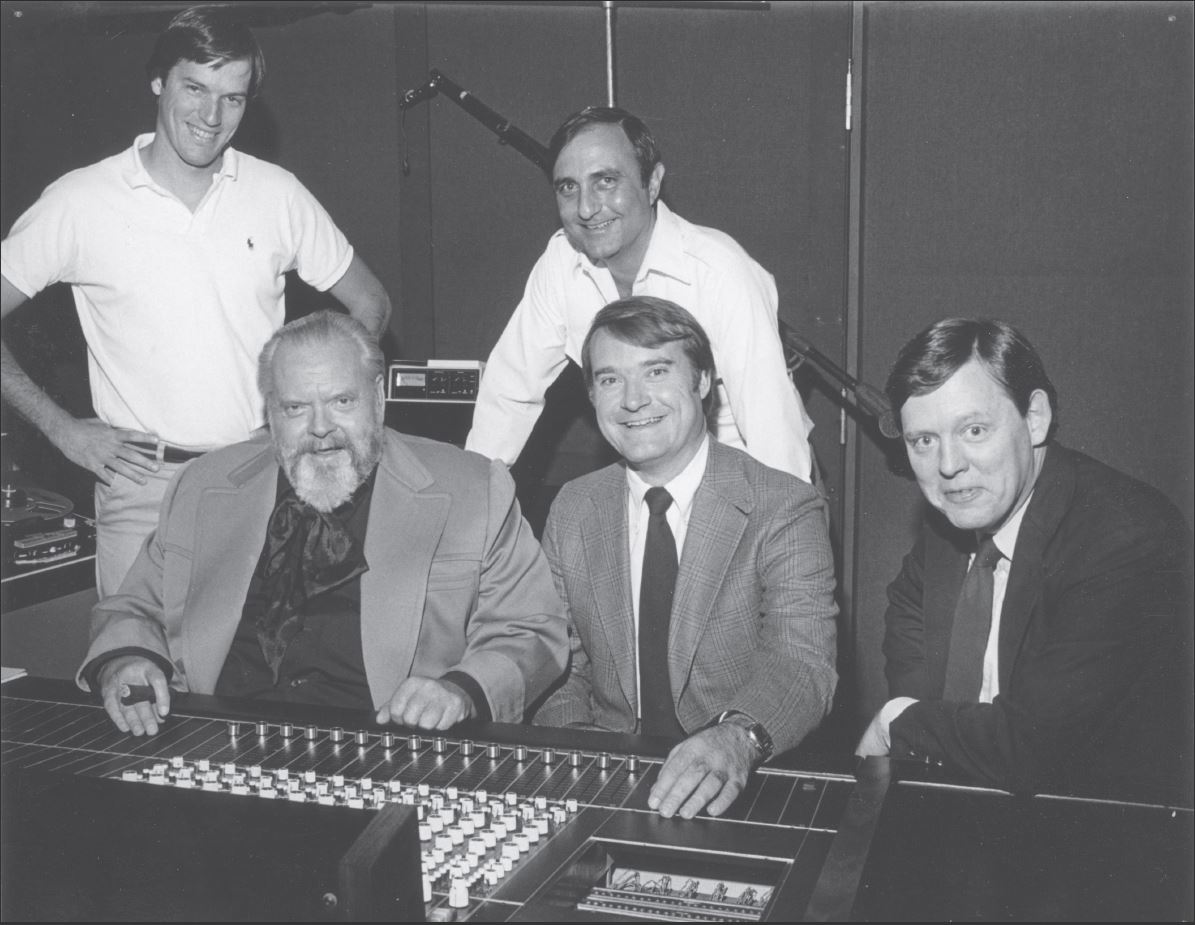 Members of Doe-Anderson Account and Creative Teams with acclaimed actor Orson Welles at radio production session for North American Van Lines in mid-1970s.