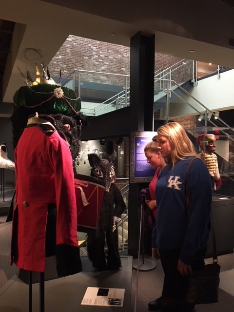 Two girls looking at nutcracker outfit.JPG