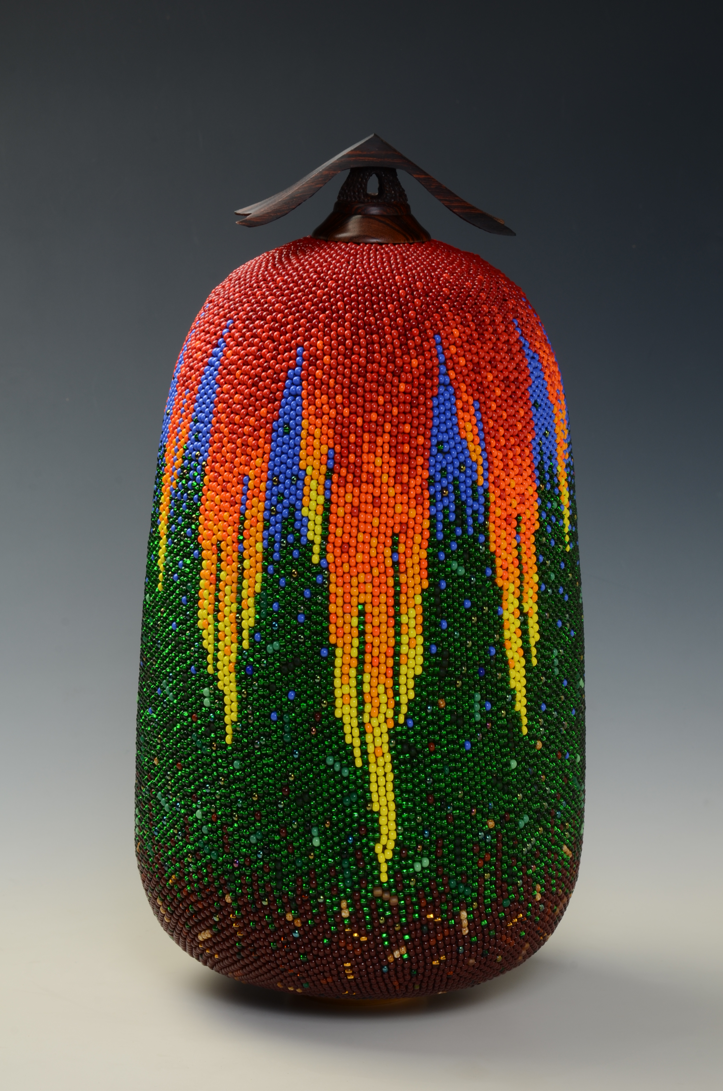 """""""Earth and Fire Urn"""" by Linda Fifield. Stitched beadwork over hollow, turned wooden vessel."""