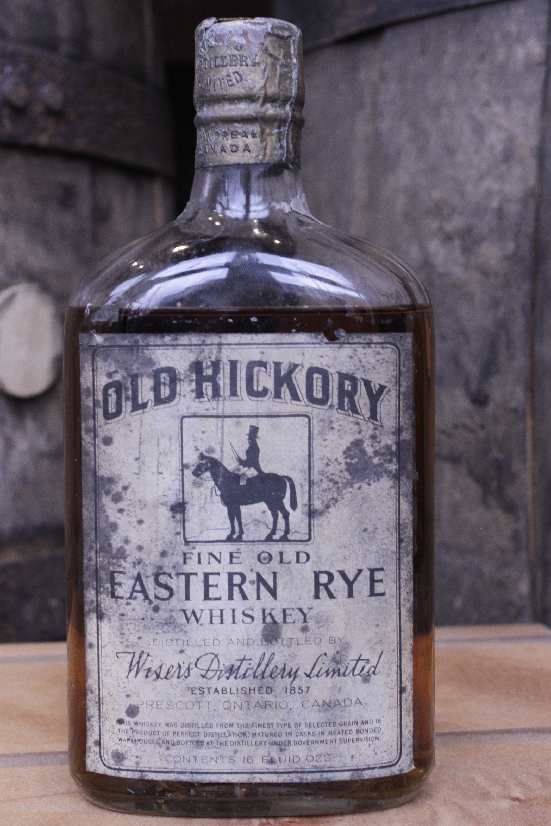 OLD HICKORY FINE OLD EASTERN RYE WHISKEY    About the Product   One pint of rye whiskey, bottled in bond. Distilled by Wiser's Distillery Limited, and bottled in 1925 by Wiser's Distiller Limited.  The product of perfect distillation, this whiskey was distilled from the finest type of selected grain, matured in casks in heated bonded warehouses, and bottled at the distillery under government supervision. The bottle's markings indicate that it was wax-dipped in Montreal and sealed in Ottawa.   About the Distillery   Wiser's Distillery Limited (1857 ­– 1924); Canadian Industrial Alcohol Co. (c. 1924). Prescott, Ontario, Canada.  Established in 1857 in Prescott, Ontario, JP Wiser's Distillery Limited was acquired by the Canadian Industrial Alcohol Company in 1924. This parent organization moved the distillery's operations to Corbyville, Ontario.