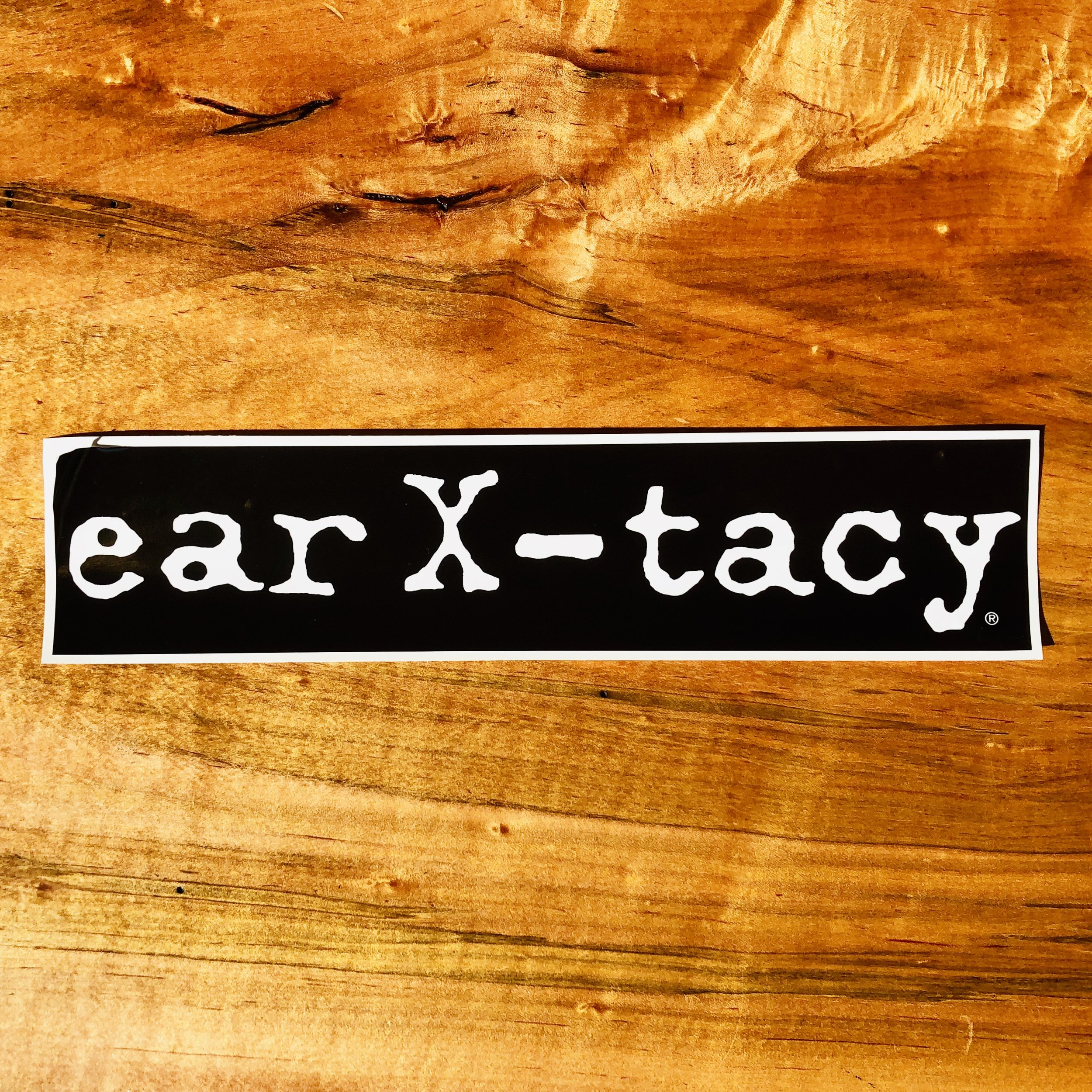 ear x-tacy bumper sticker d.jpg