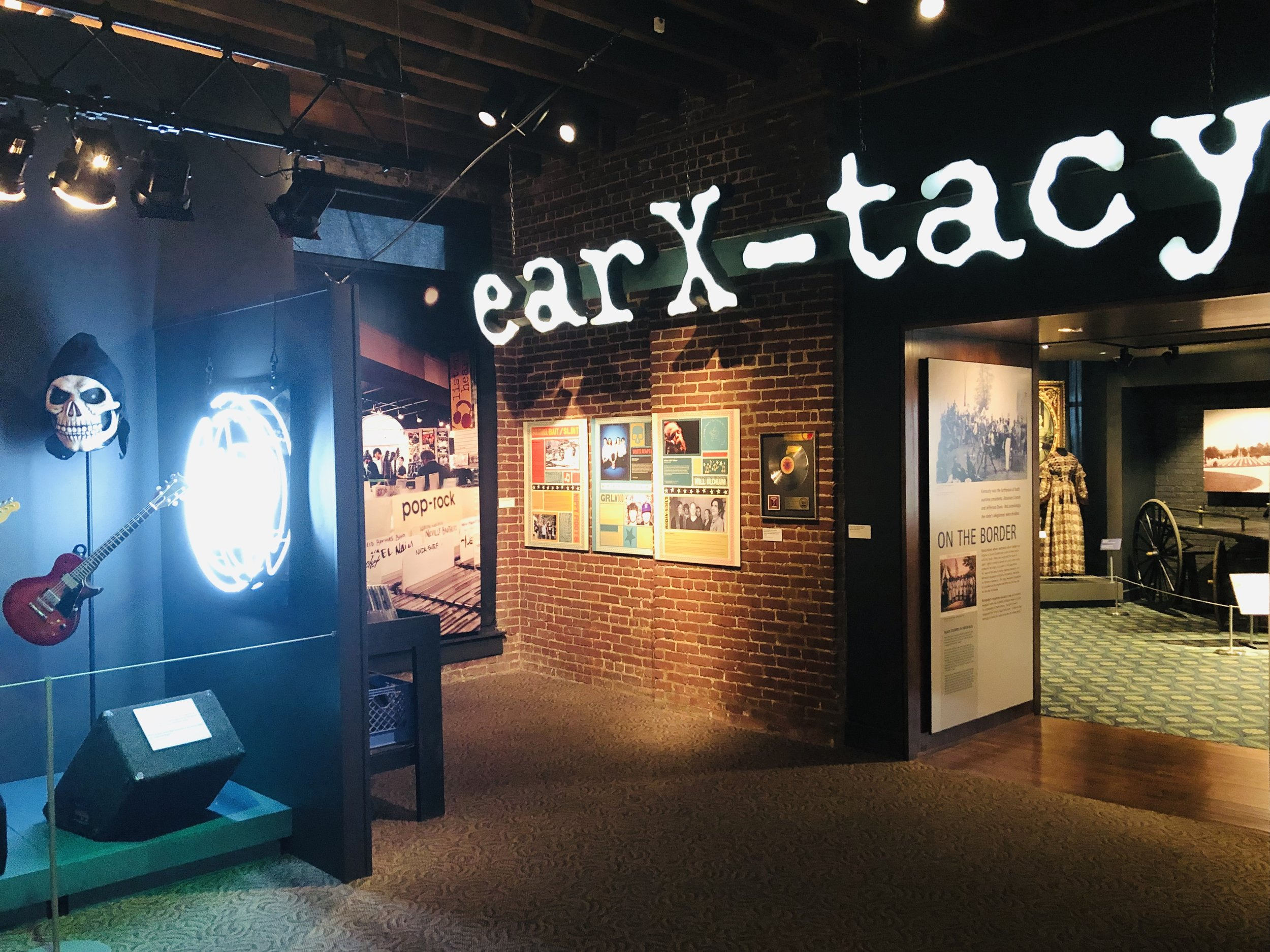 ear x-tacy sign.