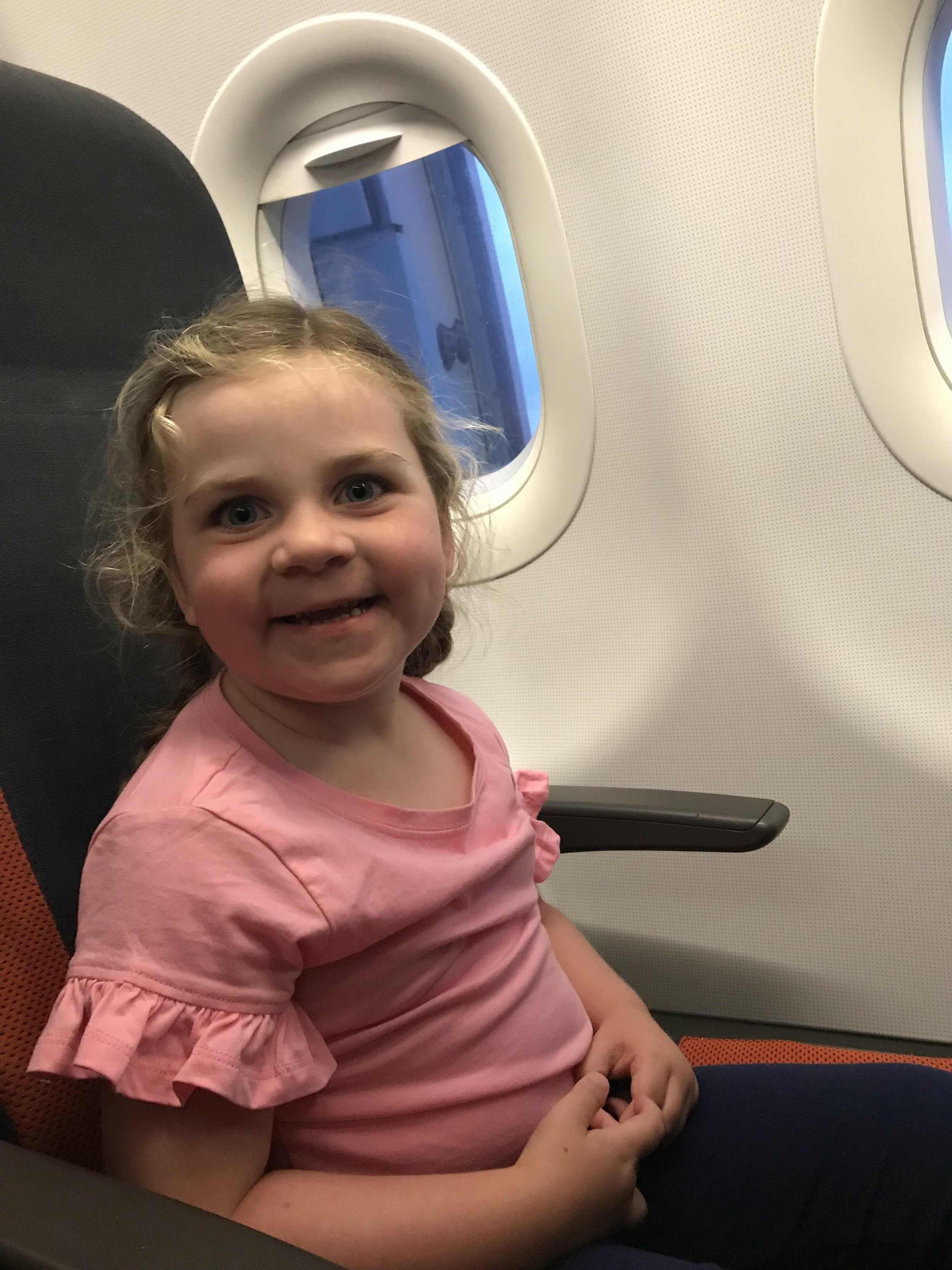 Sleepy eyes but smiling and ready for take-off!