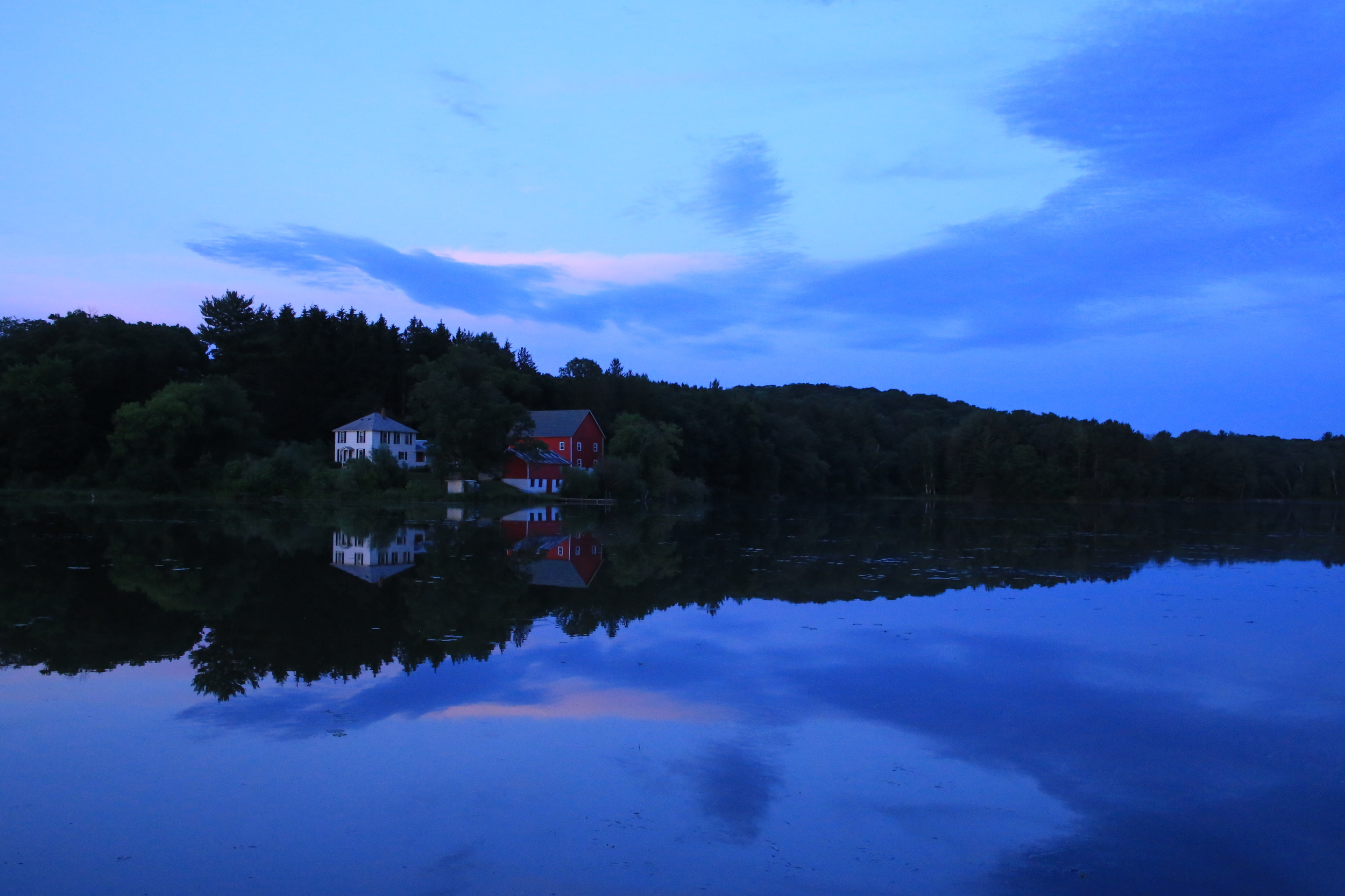 A beautiful summer evening wraps a purple light along the shore of Lily Springs.