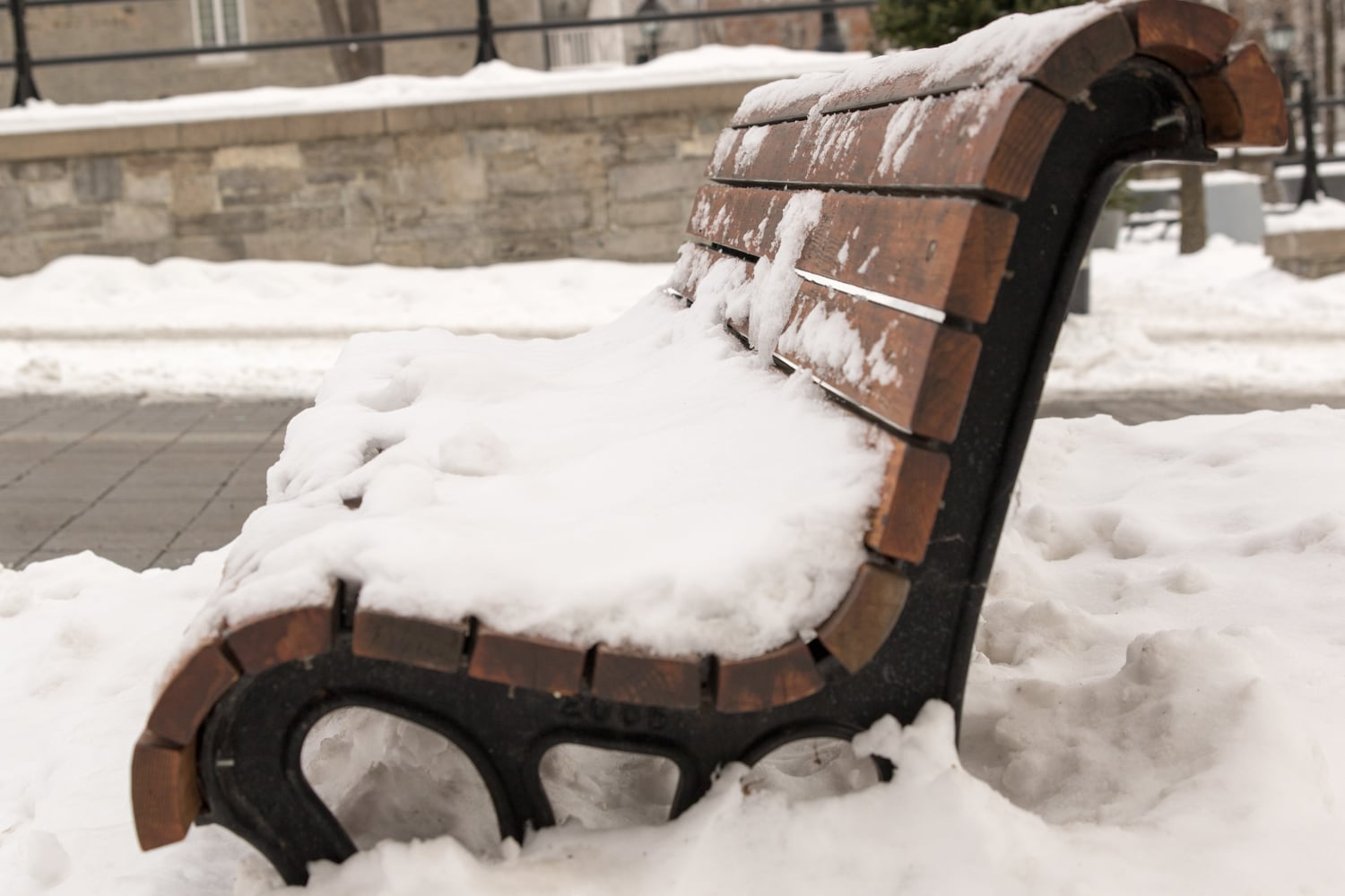 Snow covered bench in Old Montreal