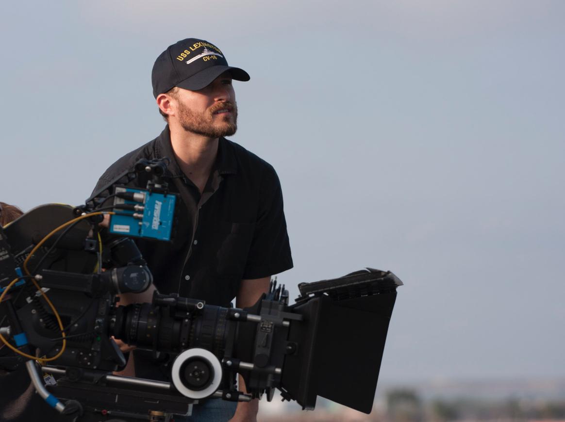 Alex Henning shooting on an Aircraft Carrier