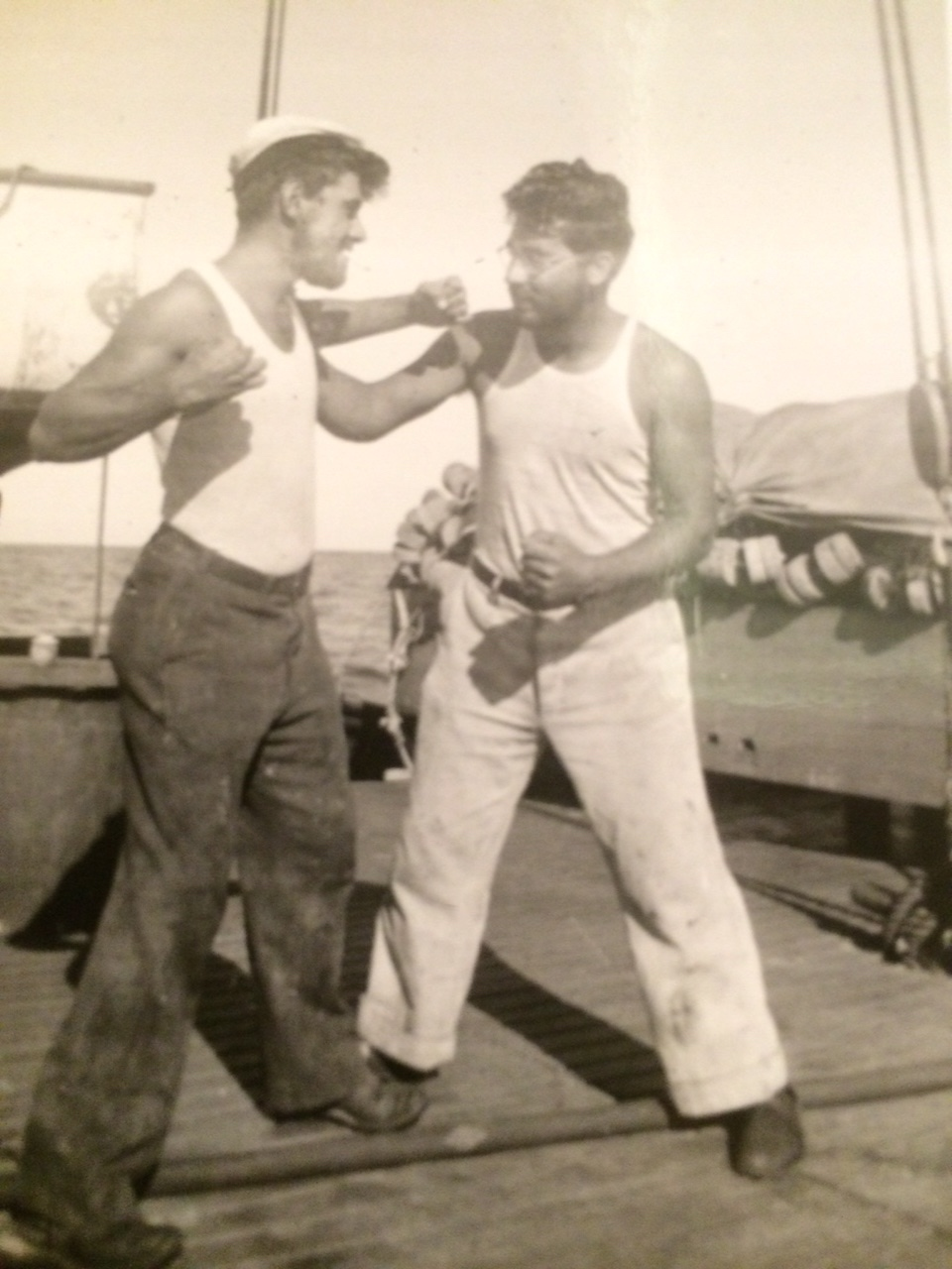 My grandfather on the right, on a fishing boat with a cousin. Possibly taking revenge for the eye?