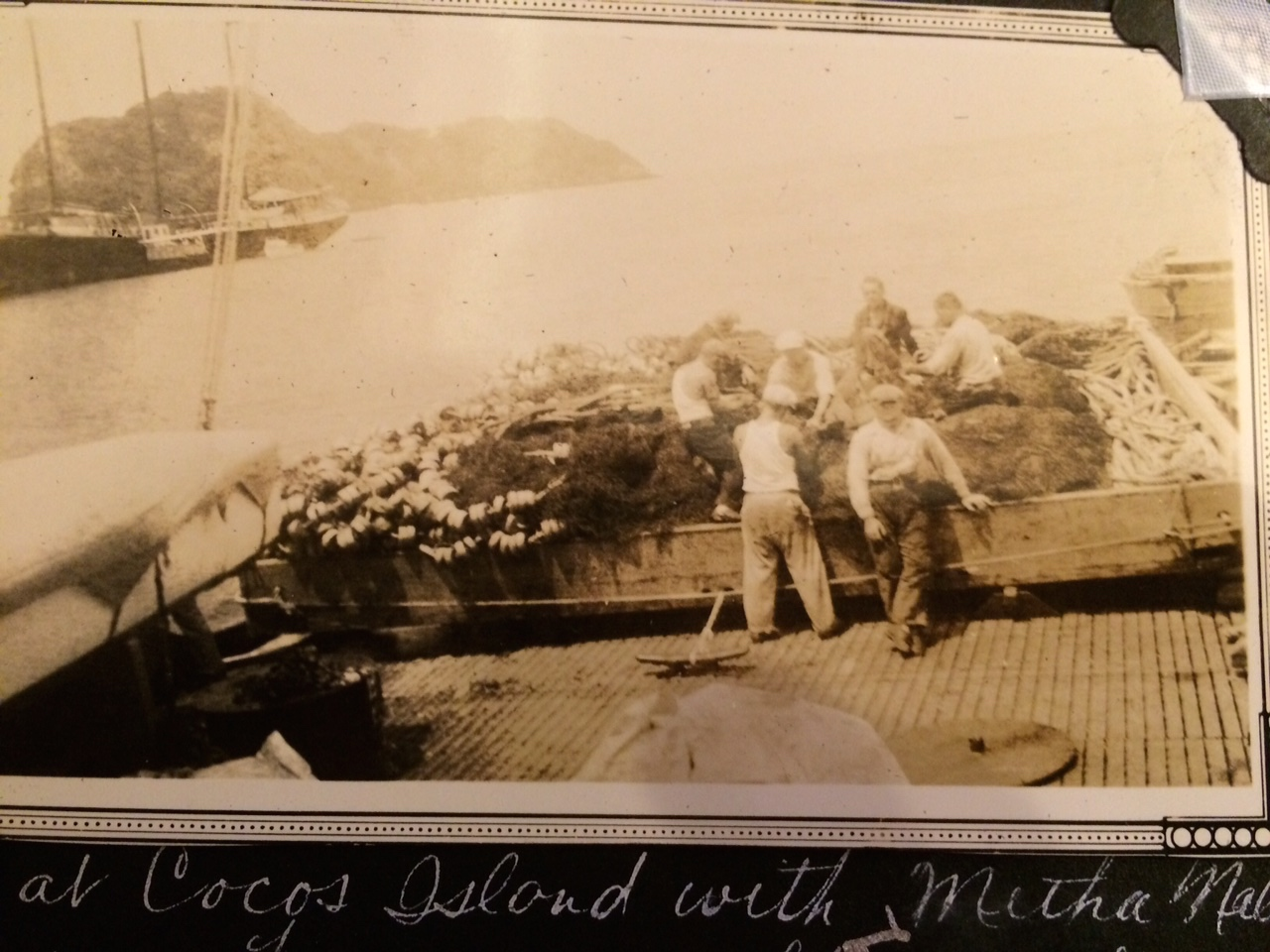 My grandfather and fellow fishermen off the coast of South America.