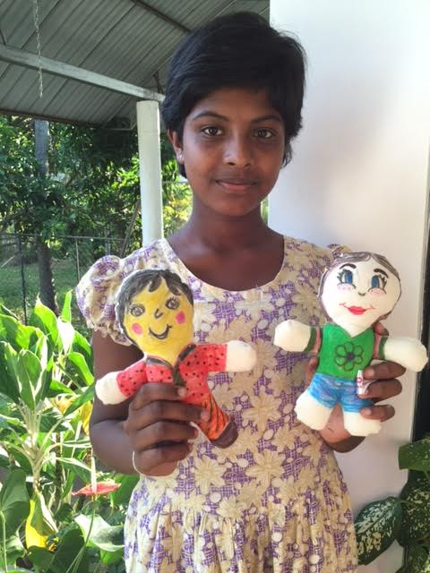 Shanika at Sputnik holding her doll with Maggie's doll