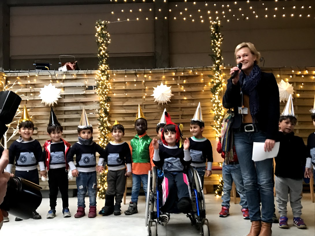 Children's performance at Holiday - Christmas Market with Ms. Claudia Peppmueller who is in charge of PR. All photos are provided by Friedensdorf international