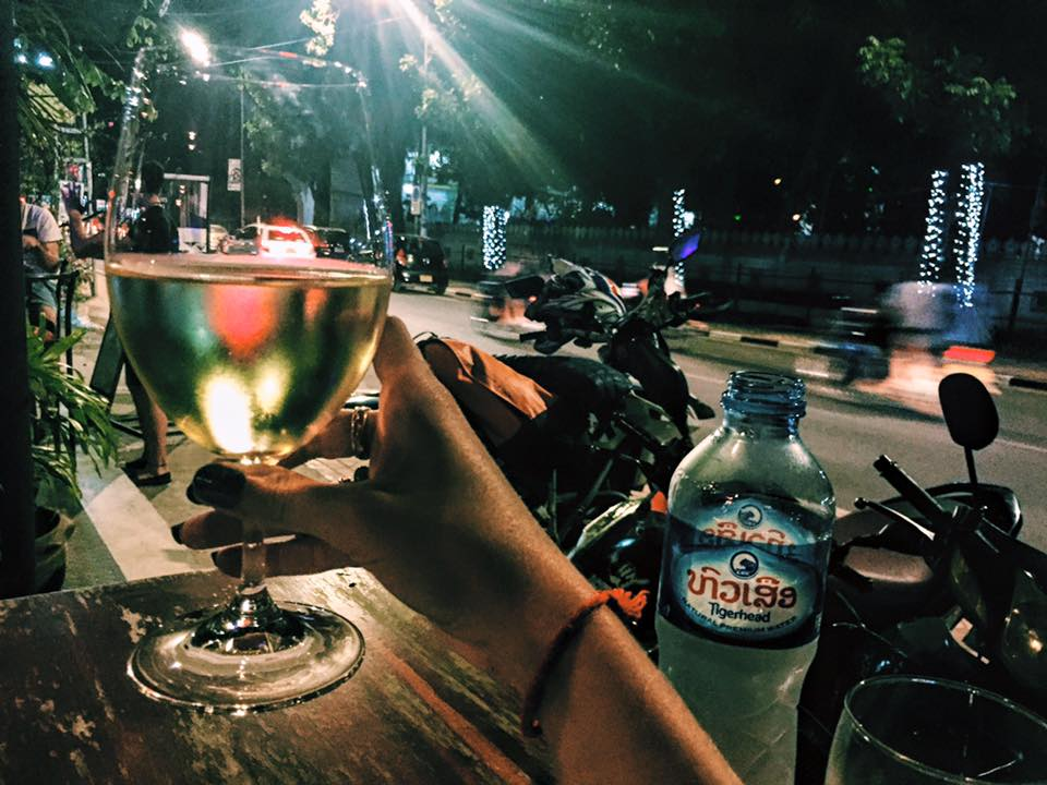 I stepped off the plane from Vietnam an hour ago & now I'm enjoying a glass of wine at a little cafe in the capital of Laos. My evening = people-watching & enjoying the excitement/novelty of a new place.