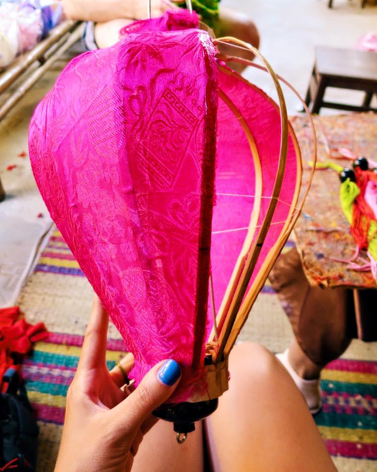 """A group of Vietnamese women taught me how to make my own silk + bamboo lantern. And by """"make my own"""", I mean fumbling their instructions until they took my shitty lantern away & fixed it themselves. Their was much pointing & laughing. Still, I made a lantern!"""