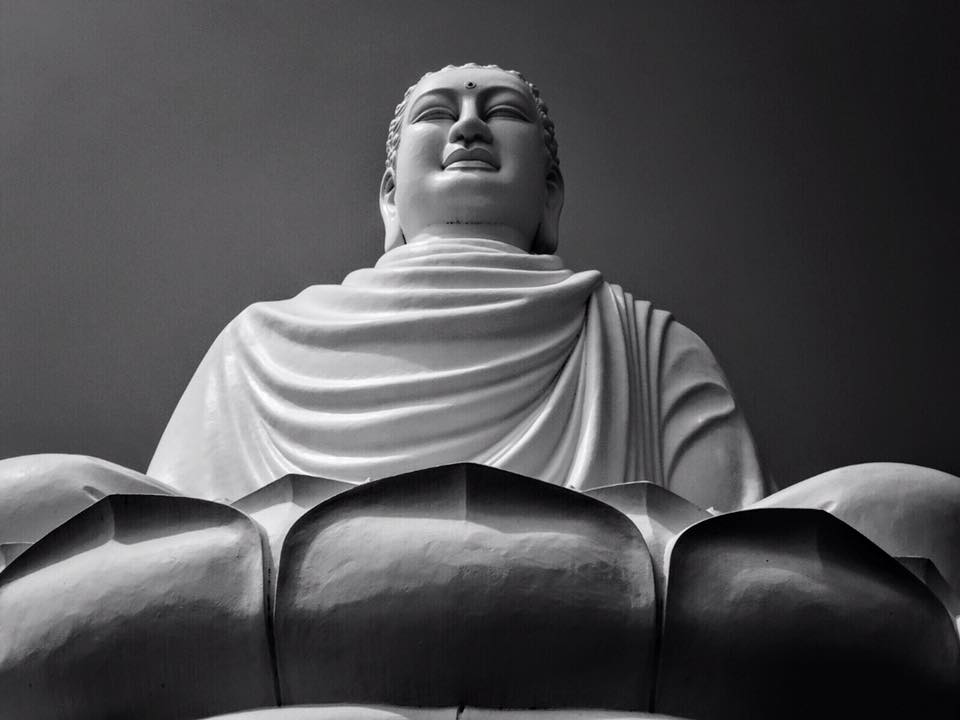 The giant white Buddha of Long Sơn Pagoda sits 24-meters tall in a lotus flower & looks over the city of Nha Trang, Vietnam. The Buddha is dedicated to seven monks who burned themselves alive in protest of the Vietnam War.